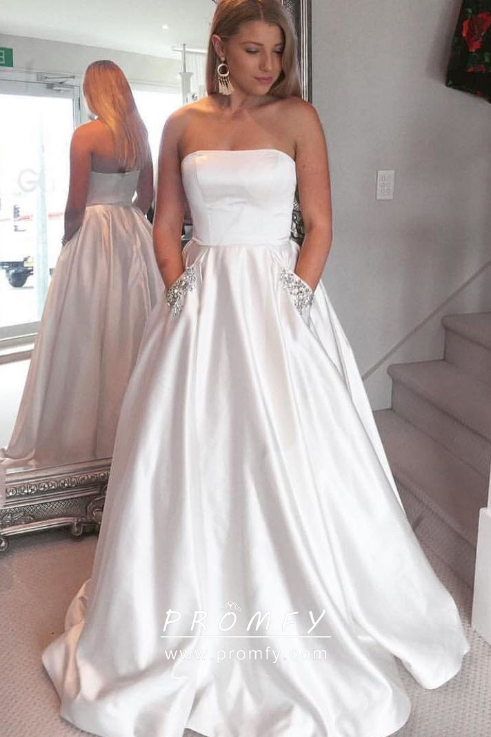 97b2f89ea0fa Simple white satin strapless straight neck ball gown with beaded pocket