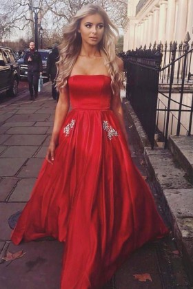 9838b4b789 Designer simple red satin strapless puffy long prom dress with beaded pocket