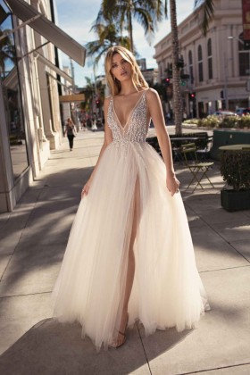6ea00170df7 Sexy sheer beaded ivory tulle high split plunging V neckline A line formal  gown